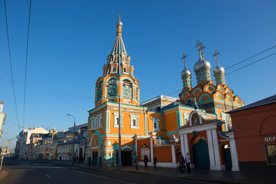 MOSCOW, STREET GREAT POLYANKA 29A, RUSSIA - FEBRUARY 22, 2020: Church of St. Gregory of Neocaesarea  in Darbitz. Bright red green sanctuary in the city center. Old historical building built in 1668