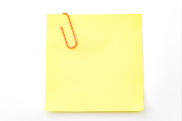 Office memo and reminder note concept with blank self adhesive yellow sticky note with paperclip isolated on white background with copy space and clipping path cutout Wall mural