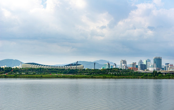 Seoul or Jamsil Olympic Stadium  built for the 1988 Summer Olympics and the 10th Asian Games in 1986, view across Han river.