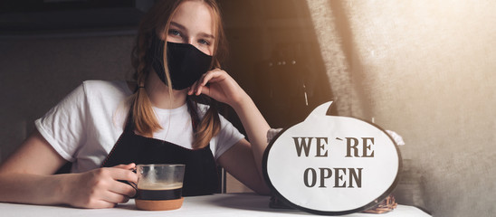 Coronavirus covid 19.Coffee shop woman owner with face mask, open after lockdown quarantine.End...