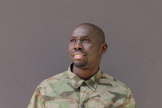 Soldier Portrait Face, Black African Man wearing camouflage uniform