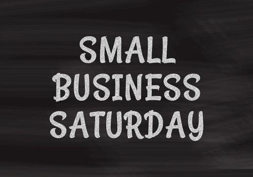 Small Business Saturday written in white chalk on a black chalkboard