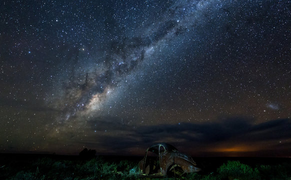 very old car wreck under milky way, starscape, nightscape