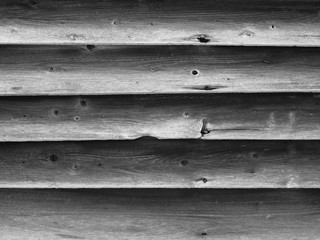 Black and white wooden slats on the side of an old historic building