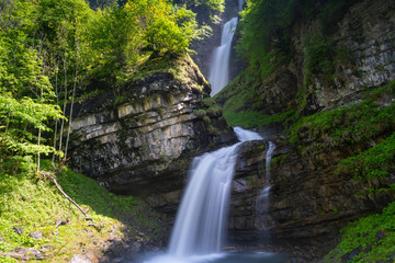 Wall Mural - view of the idyllic Diesbach creek waterfall in the Swiss Alps near Braunwald and Glarus in the spring