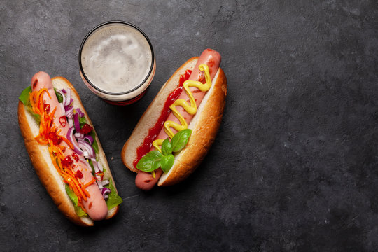 Various hot dog and glass of beer