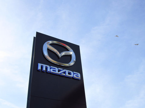 LJUBLJANA, SLOVENIA - MARCH 22 2019: Brand logo at the entrance to Mazda dealership. Mazda is a Japanese multinational car manufacturer.