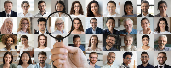 Photo sur Toile Chasse Employer hand holding magnifying glass choosing old middle aged female candidate among young multiethnic professional people faces collage. Human resource, headhunting, senior job opportunity concept.