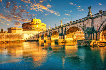 Saint Angel Castle and bridge over the Tiber river in Rome at sunrise