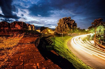 Fotomurales - High Angle View Of Light Trails On Country Street At Night
