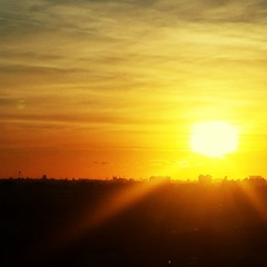 Fototapeten Gelb Scenic View Of Silhouette Landscape Against Sky During Sunset