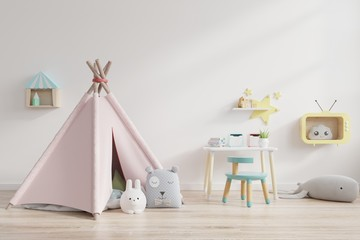 Children's playroom with tent and table sitting behind the white wall.