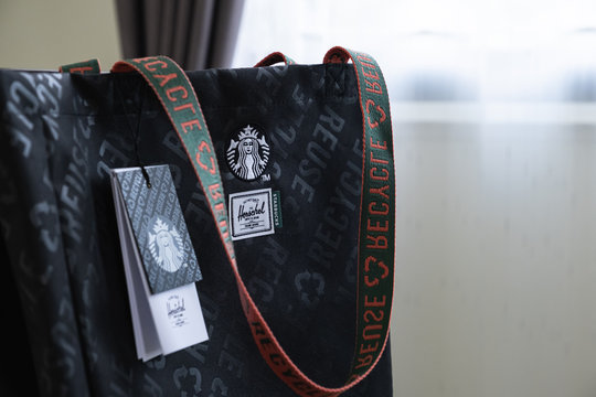 CHIANG MAI, THAILAND: May 13, 2020 : Starbucks x Herschel bag made from recycled plastic and drinkware