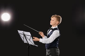 Little conductor on dark background