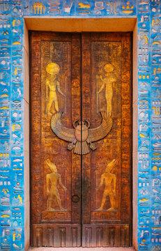 Door with images of egyptian gods and pharaohs. Ancient Egypt scene, mythology. Life of egyptiansruins