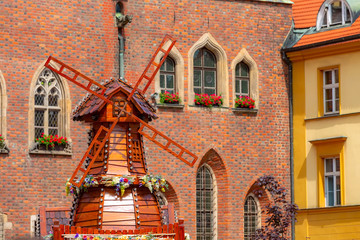 Wroclaw, Poland Old Town Hall and decorative windmill at Market Square