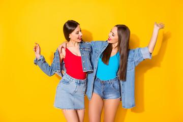 Portrait of enthusiastic lovely funky girls best fellows enjoy together walk weekend feel rejoice...