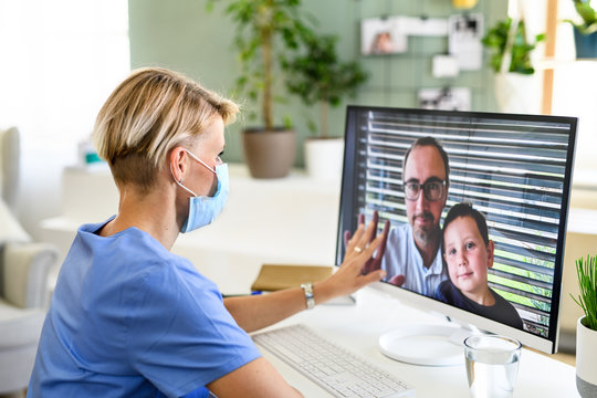 Woman doctor having video call with husband and son, social distancing concept.