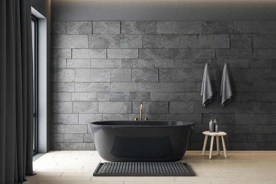 Minimalistic gray bathroom interior with decorative objects.