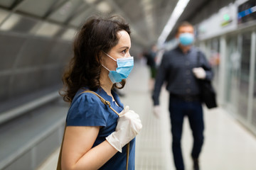Woman in medical mask waiting for subway train