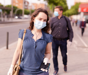 Residents of the city in protective masks against coronavirus on the street