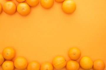 top view of ripe juicy whole oranges on colorful background