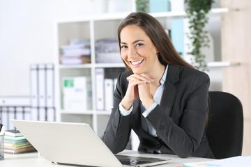 Happy executive posing looking at camera at office