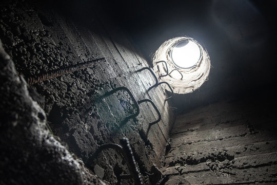 View from the underground communication to the surface through the manhole. Exit to the surface from the drainage through the manhole during rain.