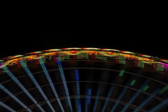 Abstract neon lights on a wonder wheel