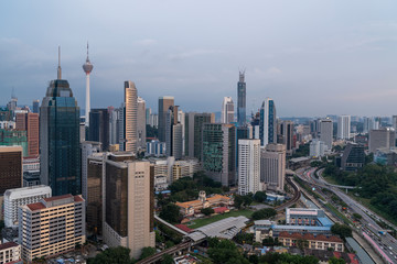 Canvas Prints Kuala Lumpur Panoramic view of Kuala Lumpur skyline at sunset. City center of capital of Malaysia. Contemporary buildings exterior with glass.