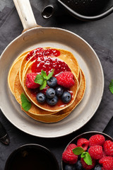 Delicious homemade pancakes with summer berries
