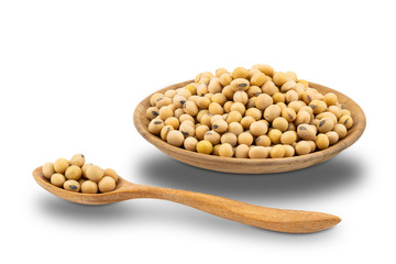Fototapete - Soy beans in wooden plate and in wooden spoon on white background with clipping path.