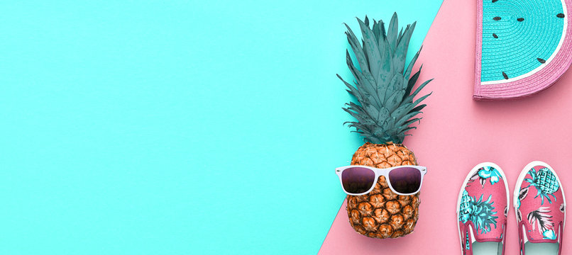 Fashion. Pineapple hipster in sunglasses, stylish sneakers, handbag. Minimal concept, summer accessories, tropical pineapple. Creative art fashionable concept, summertime, banner