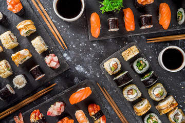 Foto auf Gartenposter Bekannte Orte in Asien Japanese food. Big sushi set. Assorted set of various sashimi, maki and sushi rolls with different fillings - tuna, sea bass, salmon, shrimp, vegetables. Flatlay copy space