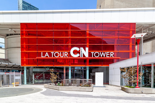 Toronto, Canada - May 16, 2020: CN Tower entrance and CN Tower sign in English and French language in Toronto, Canada. The CN Tower is concrete communications and observation tower.