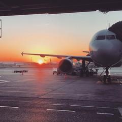 Foto op Aluminium Vliegtuig Airplane On Airport Runway Against Sky During Sunset