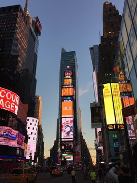 Low Angle View Of Illuminated Billboards On Skyscrapers In Times Square