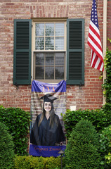 A banner celebrating a college graduate is placed outside a home in Aexandria, Virginia