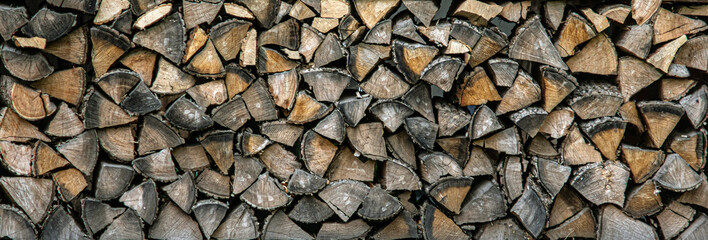 Keuken foto achterwand Brandhout textuur Wood logs background texture. Stack of firewood.