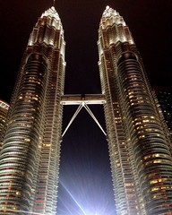 Wall Murals Kuala Lumpur Low Angle View Of Petronas Towers Against Sky In City At Night