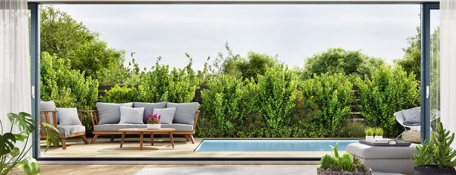 Cozy patio area with garden furniture sliding doors and swimming pool