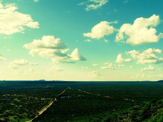 Foto auf AluDibond Reef grun View Of Countryside Landscape Against The Sky