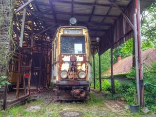 Locomotive Under Shed On Railroad Track