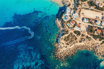 Tropical paradise beach with mediterranean sea water, aerial view. Travel and tourism concept. Fototapete