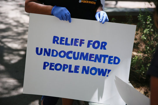 Protesters demand a relief fund for undocumented people during the coronavirus disease (COVID-19) crisis outside Phoenix City Hall