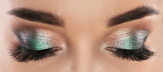 Young woman with beautiful long eyelashes, closeup view. Banner design