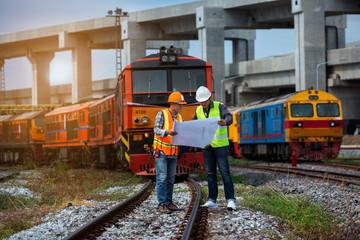 construction worker in uniform on locomotive background.