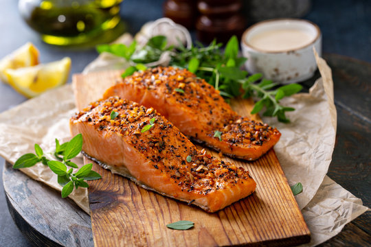 Cedar plank grilled or roasted salmon with herbs, garlic and spices