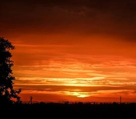 Foto auf AluDibond Rot kubanischen Idyllic Shot Of Orange Sunset Sky Over Silhouette Landscape