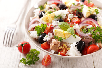 Wall Mural - mixed vegetable salad with rice, egg, onion, tomato and olive